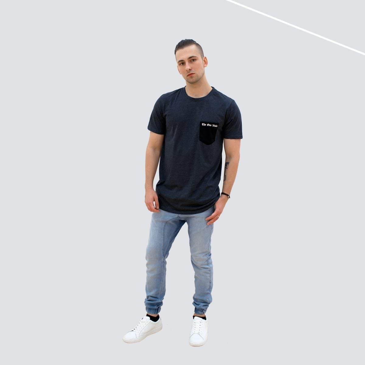 man wearing pocket tee