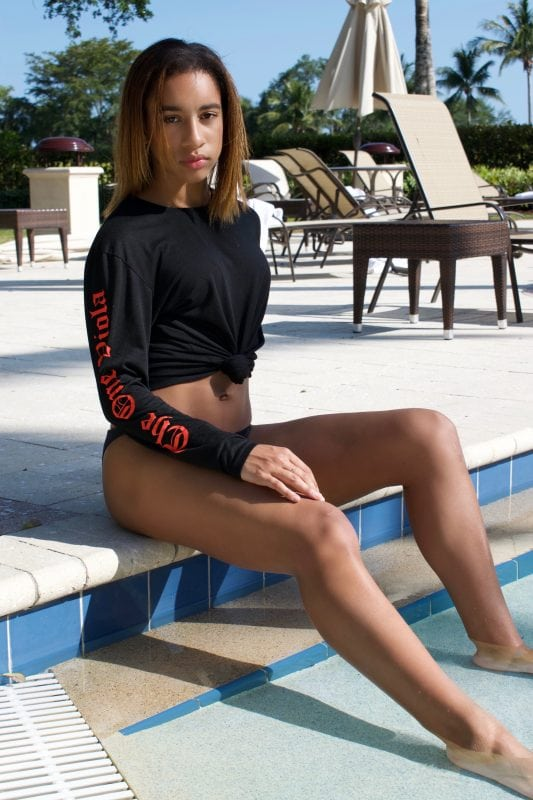 girl by pool in black long sleeve