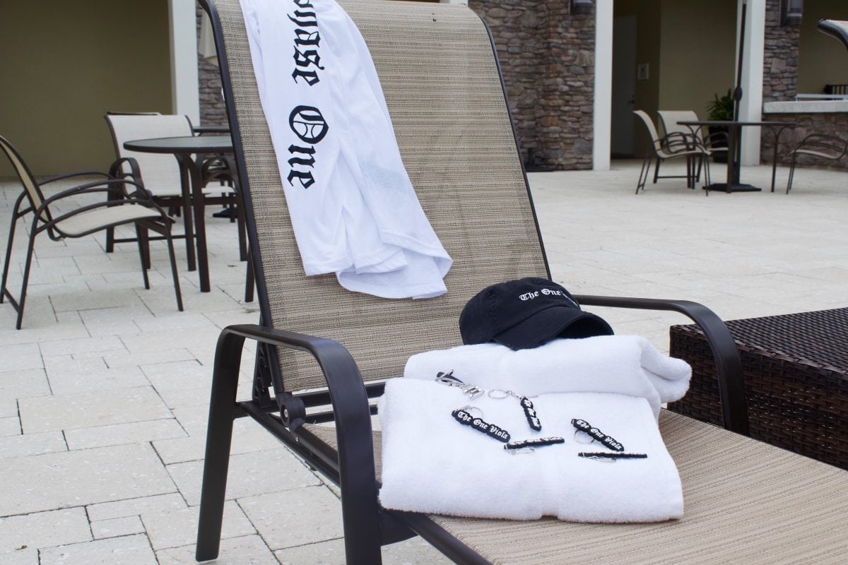 towels and hat and shirt by poolside
