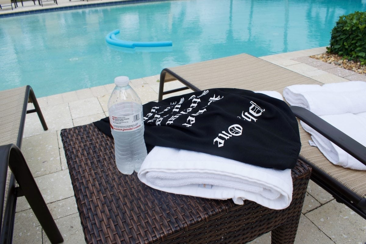 shirt and water by poolside